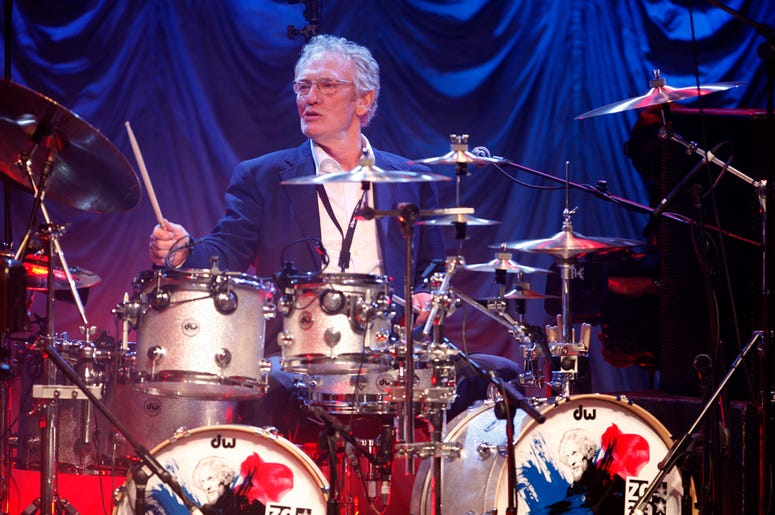 In this Sunday, Dec. 7, 2008 file photo, British musician Ginger Baker performs at the 'Zildjian Drummers Achievement Awards' at the Shepherd's Bush Empire in London. (AP Photo/MJ Kim, File)