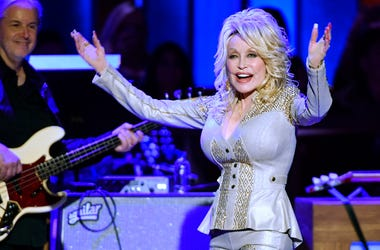In this Saturday, Oct. 12, 2019, photo Dolly Parton performs at her 50th Opry Member Anniversary at the Grand Ole Opry in Nashville, Tenn. (Larry McCormack/The Tennessean via AP)