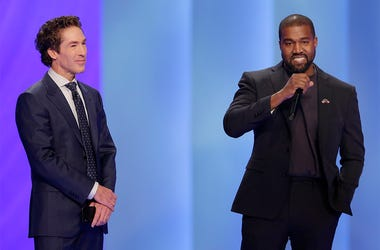 Rapper Kanye West, right, answers questions from Joel Osteen, left, during a service at Lakewood Church, Sunday, Nov. 17, 2019, in Houston. (AP Photo/Michael Wyke)