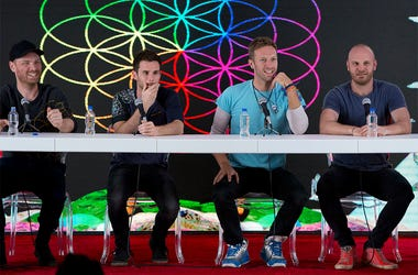 In this Friday, April 15, 2016 file photo, members of British band Coldplay, from left, Jonny Buckland, Guy Berryman, Chris Martin, and Will Champion, participate in a press conference at Foro Sol in Mexico City. (AP Photo/Rebecca Blackwell, file)