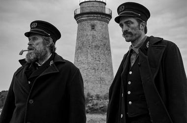 "This image released by A24 Films shows Willem Dafoe, left, and Robert Pattinson in a scene from ""The Lighthouse."" (Eric Chakeen/A24 Pictures via AP)"