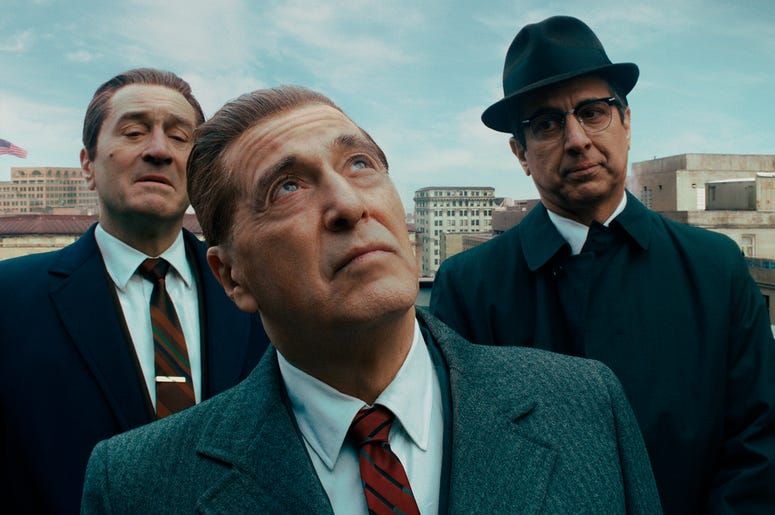 """This image released by Netflix shows, from left, Robert De Niro, Al Pacino and Ray Romano in a scene from """"The Irishman."""" On Monday, Dec. 9, 2019, Pacino was nominated for a Golden Globe for best supporting actor in a motion picture for his role in the fi"""