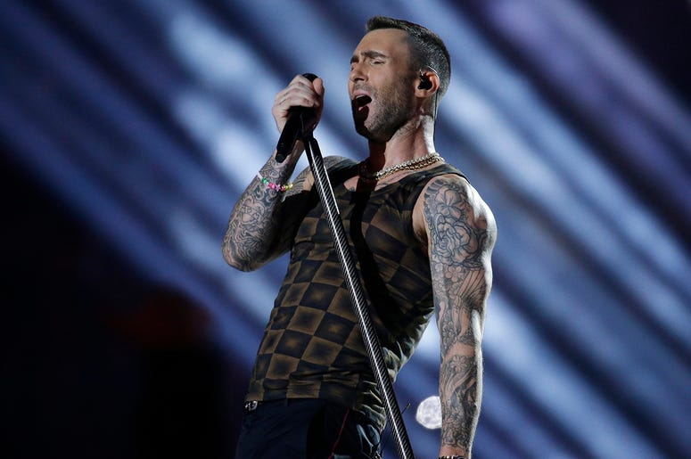 In this Feb. 3, 2019 file photo, Adam Levine of Maroon 5 performs during halftime of the NFL Super Bowl 53 football game between the Los Angeles Rams and the New England Patriots in Atlanta. (AP Photo/Mark Humphrey, File)