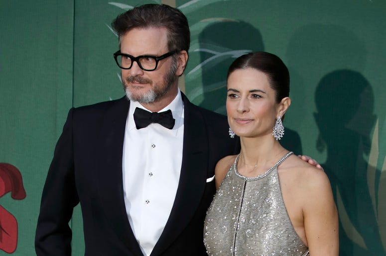 In this file photo dated Sunday, Sept. 22, 2019, British actor Colin Firth and his wife Livia, pose for photographers upon arrival at the Green Carpet Fashion Awards in Milan, Italy. (AP Photo/Luca Bruno, FILE)