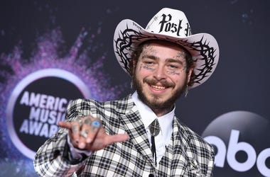 In this Nov. 24, 2019, file photo Post Malone arrives at the American Music Awards at the Microsoft Theater in Los Angeles. (Photo by Jordan Strauss/Invision/AP, File)
