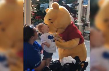 Winnie the Pooh and 18-month-old boy (Photo credit: Jessie Barber/Radio.com)