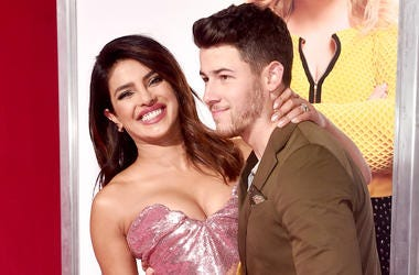 "LOS ANGELES, CALIFORNIA - FEBRUARY 11: (L-R) Priyanka Chopra and Nick Jonas attend the premiere of Warner Bros. Pictures' ""Isn't It Romantic"" at The Theatre at Ace Hotel on February 11, 2019 in Los Angeles, California. (Photo by Alberto E. Rodriguez/Getty"
