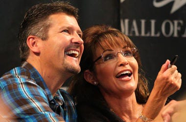 BLOOMINGTON, MN - JUNE 29: Todd Palin and Sarah Palin greet fans at the Best Buy Rotunda at Mall of America on June 29, 2011 in Bloomington, Minnesota. (Photo by Adam Bettcher/Getty Images)