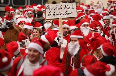 LONDON, ENGLAND - DECEMBER 12: Londoners dressed in Santa Claus costumes participate in 'SantaCon', a Santa-themed pub crawl across the capital, on December 12, 2009 in London, England. Similar SantaCon events take place in various cities around the world