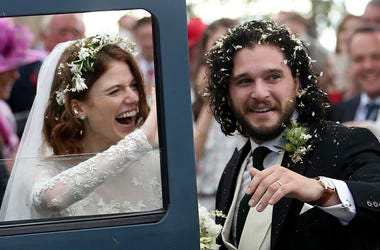 """Actors Kit Harington and Rose Leslie react as they leave after their wedding ceremony, at Rayne Church, Kirkton of Rayne in Aberdeenshire, Scotland, Saturday June 23, 2018. Former """"Game of Thrones"""" co-stars Kiet Harington and Rose Leslie married near the"""
