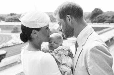 This is an official christening photo released by the Duke and Duchess of Sussex on Saturday, July 6, 2019, showing Britain's Prince Harry, right and Meghan, the Duchess of Sussex with their son Archie Harrison Mountbatten-Windsor at Windsor Castle with w