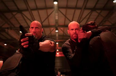 "This image released by Universal Pictures shows Dwayne Johnson, left, and Jason Statham in a scene from ""Fast & Furious Presents: Hobbs & Shaw."" (Daniel Smith/Universal Pictures via AP)"