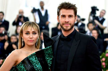 """In this May 6, 2019 file photo, Miley Cyrus, left, and Liam Hemsworth attend The Metropolitan Museum of Art's Costume Institute benefit gala celebrating the opening of the """"Camp: Notes on Fashion"""" exhibition in New York. (Photo by Charles Sykes/Invision/A"""