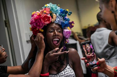 A makeup artist works on a model backstage at the dapperQ fashion show at the Brooklyn Museum on Thursday, Sept. 5, 2019, in New York. (AP Photo/Jeenah Moon)