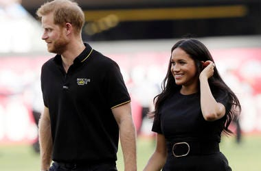 In this Saturday, June 29, 2019 file photo, Britain's Prince Harry, left, and Meghan, Duchess of Sussex, walk off the field before a baseball game in London. (AP Photo/Tim Ireland, file)
