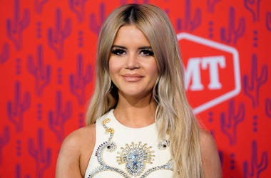 """This June 5, 2019 file photo shows Maren Morris at the CMT Music Awards in Nashville, Tenn. The Grammy-winning country singer posted of a photo of herself with her husband Ryan Hurd on Instagram on Tuesday announcing her pregnancy, saying """"the universe wo"""
