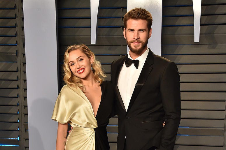 BEVERLY HILLS, CA - MARCH 4: Miley Cyrus (L) and actor Liam Hemsworth arrives at the 2018 Vanity Fair Oscar Party at the Wallis Annenberg Center for the Performing Arts on March 4, 2018 in Beverly Hills, California.(Photo by Scott Kirkland/PictureGroup/Si