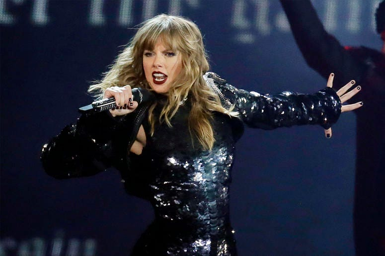 """This May 8, 2018 file photo shows Taylor Swift performing during her """"Reputation Stadium Tour"""" opener in Glendale, Ariz. (Photo by Rick Scuteri/Invision/AP, File)"""