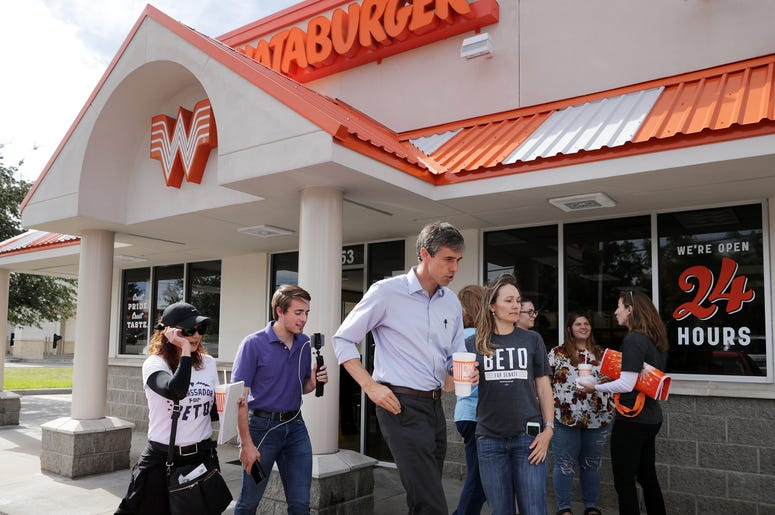 Rep. Beto O'Rourke (D-TX) (C), his Logistics and Events Manager Cynthia Cano (L), campaign Communications Director Chris Evans and O'Rourke's sister Charlotte O'Rourke head back out to canvass after lunch at a Whataburger November 3.