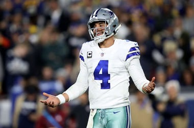 Cowboys quarterback Dak Prescott smiles during first half of game.