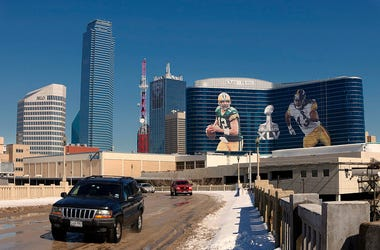 General view of the downtown skyline with Super Bowl XLV art draped from the Omni Hotel as motorists make their way along on February 5, 2011 in Dallas, Texas. The Green Bay Packers will play the Pittsburgh Steelers in Super Bowl XLV on February 6, 2011.