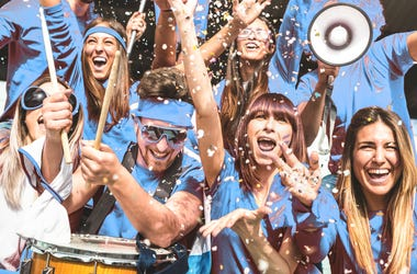 Friends people group on blue t shirts having excited fun on sport world championship final