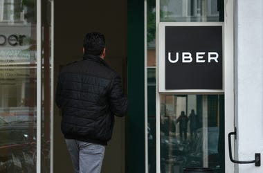 A man enters an Uber drivers registration office.