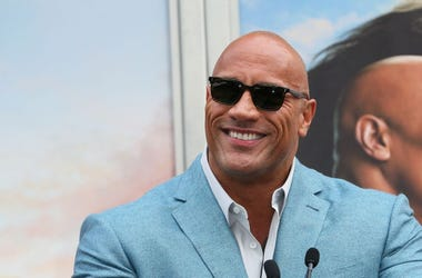 Dwayne Johnson attends a Hand and Footprint ceremony honoring Kevin Hart at the TCL Chinese Theatre IMAX on December 10, 2019 in Hollywood, California.