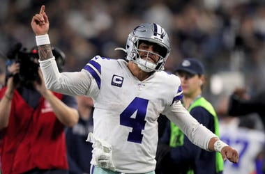Dak Prescott #4 of the Dallas Cowboys reacts in the third quarter against the Washington Redskins in the game at AT&T Stadium on December 29, 2019