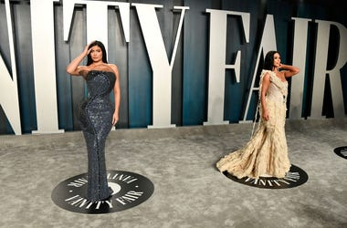 Kylie Jenner and Kim Kardashian (R) attend the 2020 Vanity Fair Oscar Party hosted by Radhika Jones in Beverly Hills, CA.