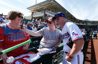 Scott Heineman #16 of the Texas Rangers takes a photo with fans prior to a Cactus League spring training game against the Chicago Cubs at Surprise Stadium on February 27, 2020 in Surprise, Arizona.