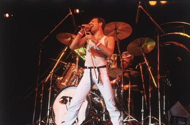 Freddie Mercury (1946 - 1991), lead singer of 70s hard rock quartet Queen, in concert in Milton Keynes