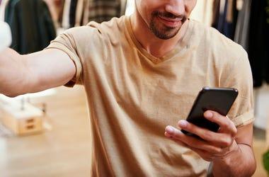 Man, Clothing Store, Texting, Phone, Smiling