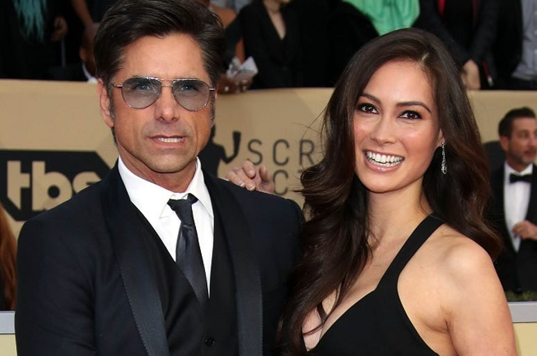Jan 21, 2018; Los Angeles, CA, USA; From left, John Stamos and Caitlin McHugh arrive at the 24th annual Screen Actors Guild Awards at the Shrine Auditorium