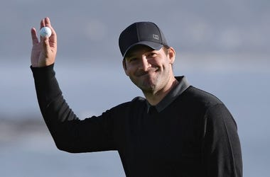 Feb 10, 2018; Pebble Beach, CA, USA; Tony Romo acknowledges the crowd on the 18th green during the third round of the AT&T Pebble Beach Pro-Am golf tournament at Pebble Beach Golf Link