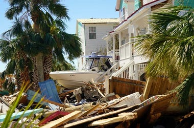 Oct 12, 2018; Mexico Beach, FL, USA; A boat appears to have been jammed beneath a home in Mexico B