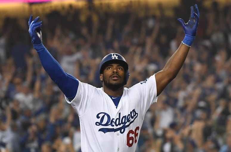 Oct 27, 2018; Los Angeles, CA, USA; Los Angeles Dodgers outfielder Yasiel Puig (66) celebrates after hitting a three run home run in the sixth inning against the Boston Red Sox in game four of the 2018 World Series at Dodger Stadium