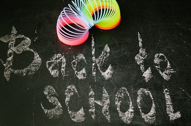 chalk with words back to school. Classroom, beginning.