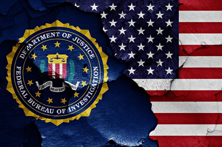 Flag of FBI and USA painted on cracked wall