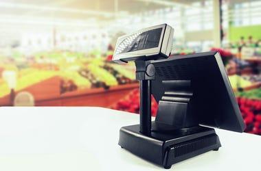 Cash register on desk at grocery store
