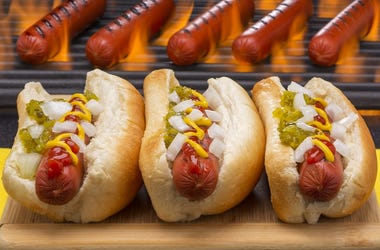 Hot Dogs Grilled in Buns Barbecue Grill Background