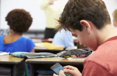 Kid Playing Games In Class