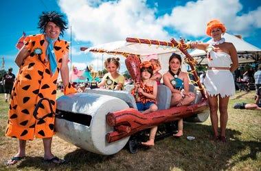 Festival goers dressed as the Flintstones on day 2 of Camp Bestival 2015, Lulworth Castle - Dorse