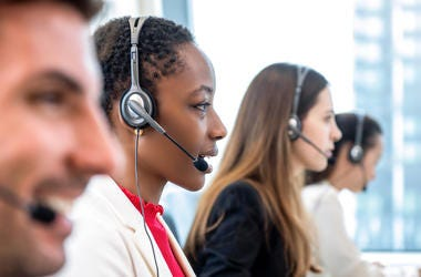 Telemarketers answering phones at a call center