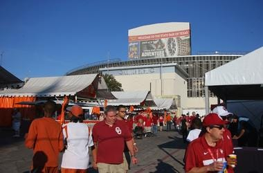 DALLAS, TX - OCTOBER 10: Fans walk through the State Fair of Texas before the 2015 AT&T Red River Showdown between the Texas Longhorns and the Oklahoma Sooners at Cotton Bowl on October 10, 2015 in Dallas, Texas. (