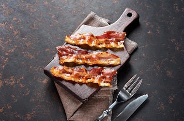 Fried Bacon, Wooden Cutting Board, Fork, Knife