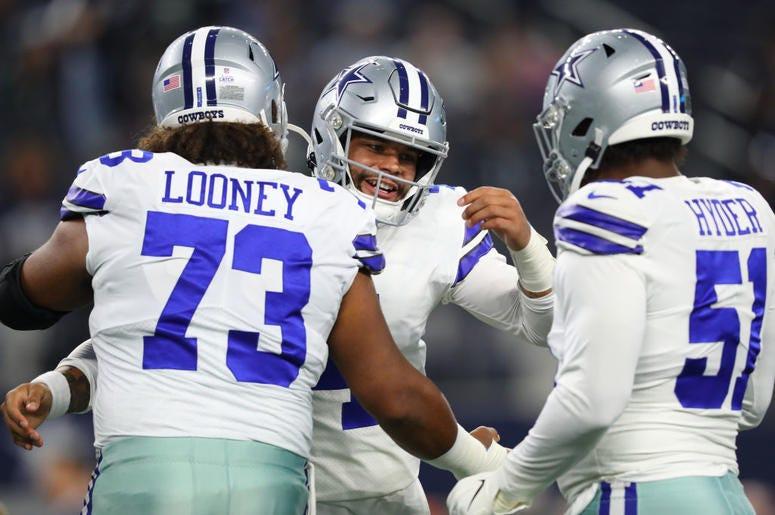Dak Prescott and Joe Looney hug before Dallas Cowboys game