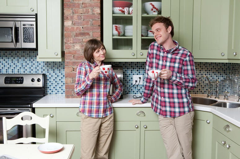 Mother and son wear matching plaid shirts