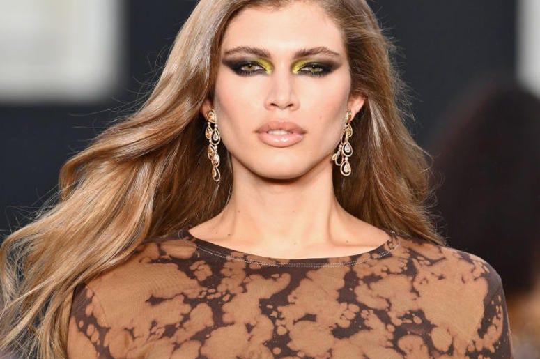 Model Valentina Sampaio struts the catwalk during a fashion show.