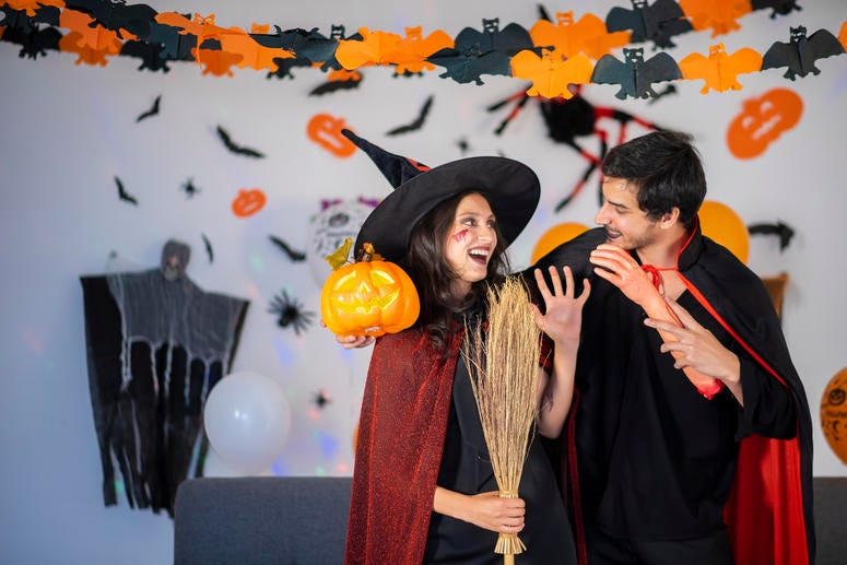 Couple dressed as witch and vampire.